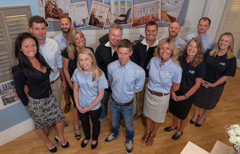 The team behind Bournemouth Plantation Shutters pose in head office