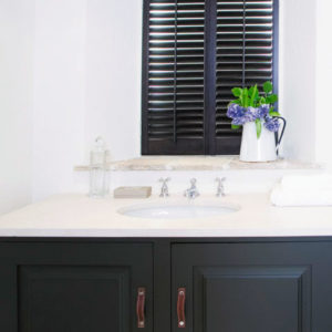 Showroom in Bebington Plantation Shutters are shown in bathroom